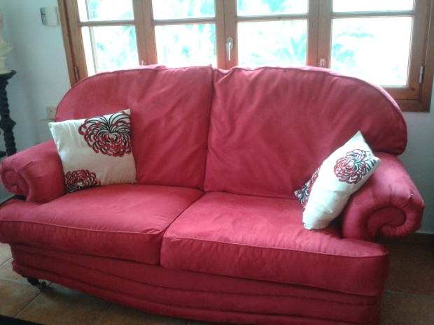 Red faux suede sofa